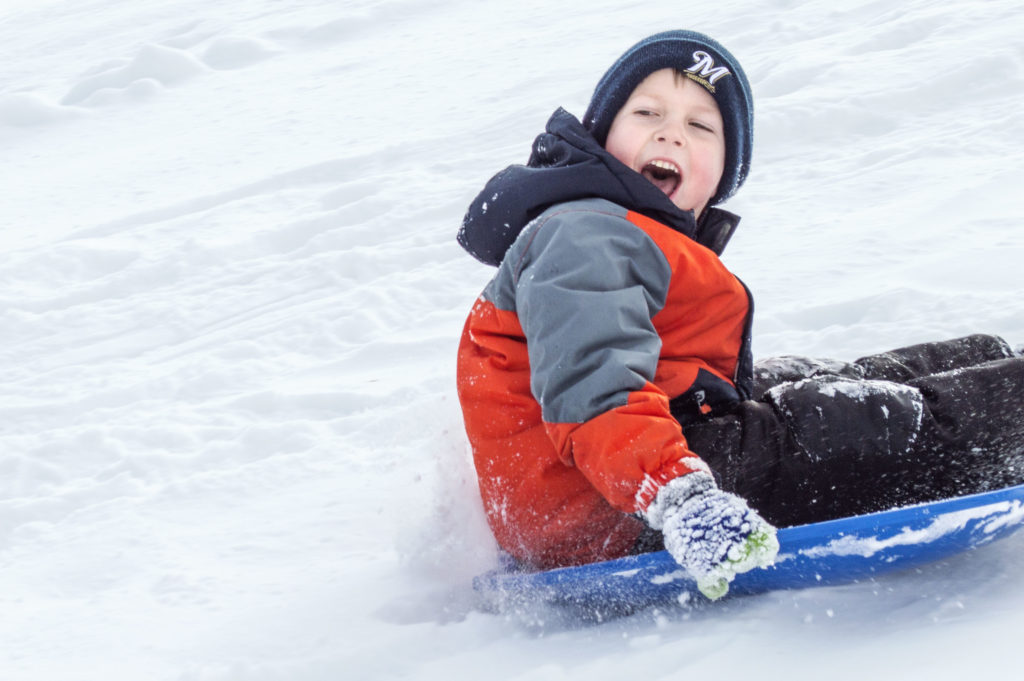 Young Boy Sledding.