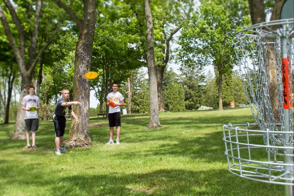 Kids playing frisbee golf.