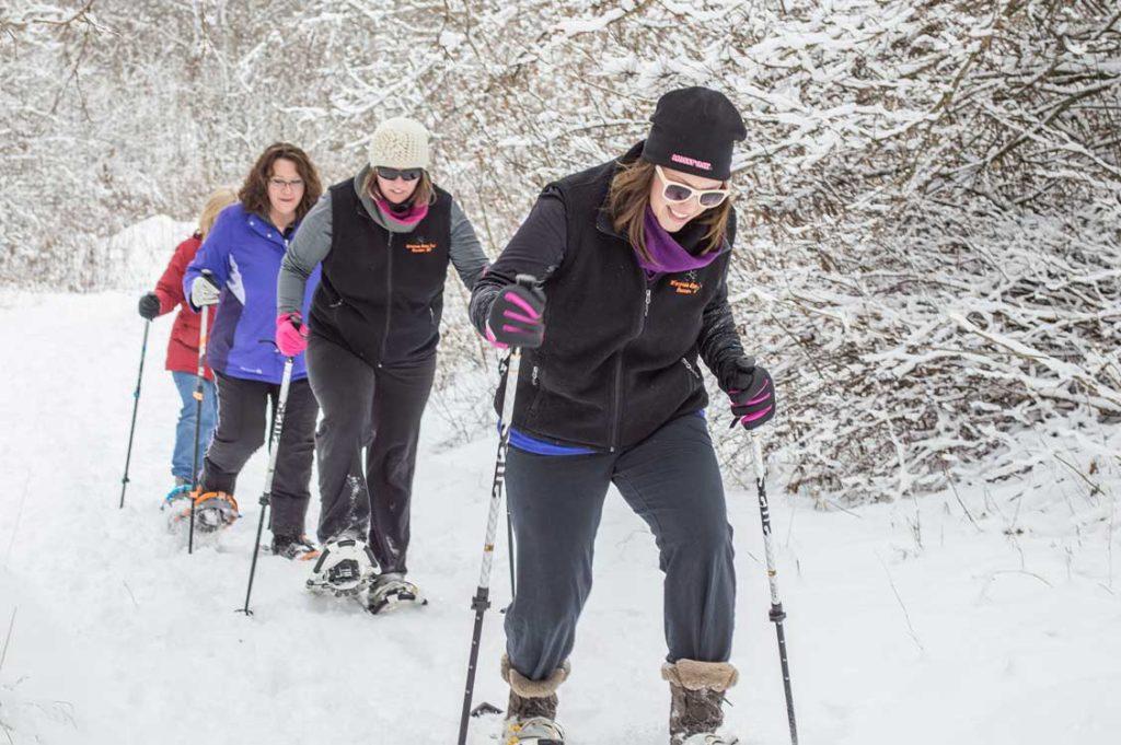 Women snowshoeing.
